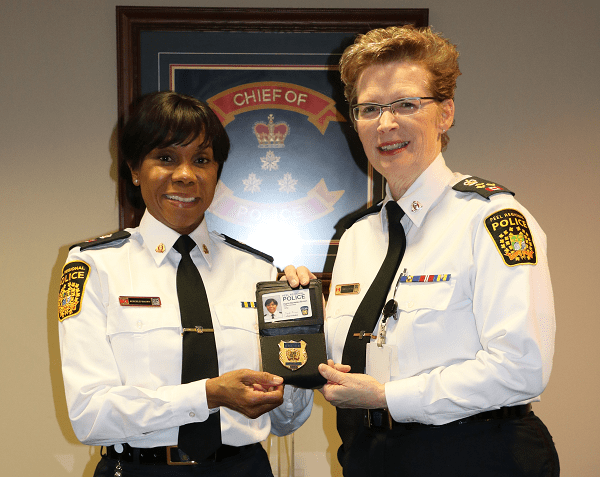 Superintendent Ingrid Berkeley-Brown being presented with her new badge on 1/129/16